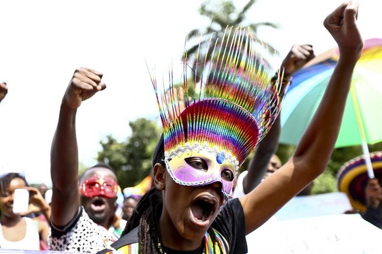 People walk in a parade as they celebrate the annulment of an anti-homosexuality law by Uganda's constitutional court in Entebbe August 9, 2014. REUTERS/Edward Echwalu