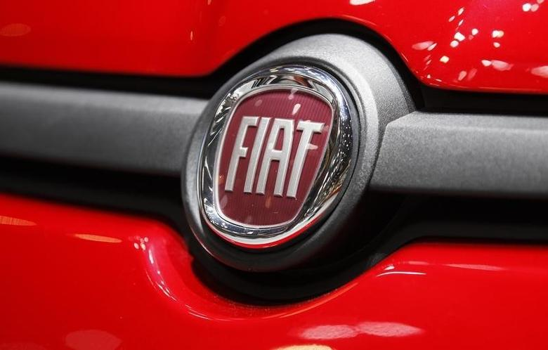 The Fiat logo is seen in a car displayed on the Fiat booth during the first media day of the Geneva Auto Show at the Palexpo in Geneva March 5, 2013.  REUTERS/Denis Balibouse