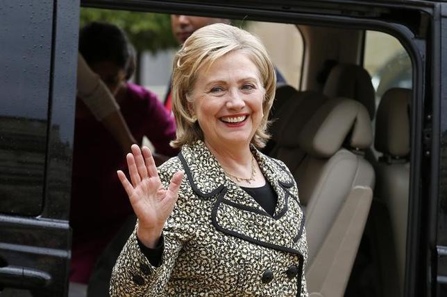 Former U.S. Secretary of State Hillary Clinton waves as she leaves after a meeting at the Elysee Palace in Paris, July 8, 2014. REUTERS/Benoit Tessier/Files