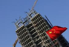 Plusieurs indicateurs pour le mois de juillet confirment le ralentissement de l'économie chinoise et suggèrent que les mesures prises par le gouvernement pour soutenir l'activité ne vont pas assez loin. /Photo d'archives/REUTERS/Kim Kyung-Hoon