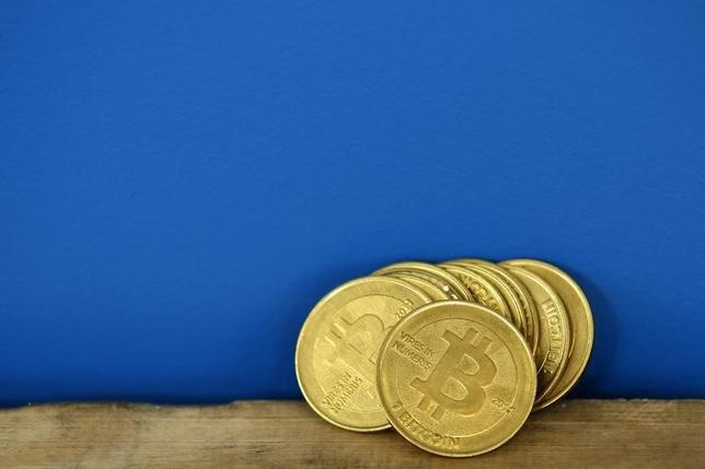 Bitcoin (virtual currency) coins are seen in an illustration picture taken at La Maison du Bitcoin in Paris July 11, 2014.   REUTERS/Benoit Tessier