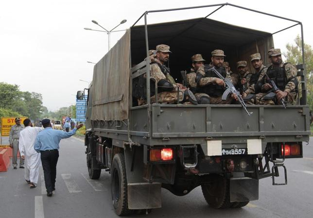 A army truck goes through a security checkpoint on the approach to the parliament building in Islamabad August 13, 2014. REUTERS/Caren Firouz