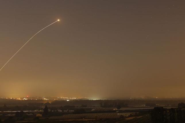 An interception by the Iron Dome anti-missile system is seen as rockets are launched from Gaza towards Israel before a 72-hour ceasefire was due to expire August 13, 2014. REUTERS/Amir Cohen