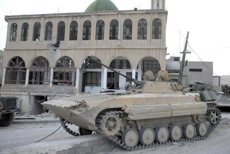 A tank belonging to the forces of Syria's President Bashar al-Assad is seen at Al-Sahl town, about 2km (a mile) to Yabroud's north, after the soldiers took control of it from the rebel fighters, in this March 3, 2014 handout photograph distributed by Syria's national news agency SANA. REUTERS/SANA/Handout via Reuters