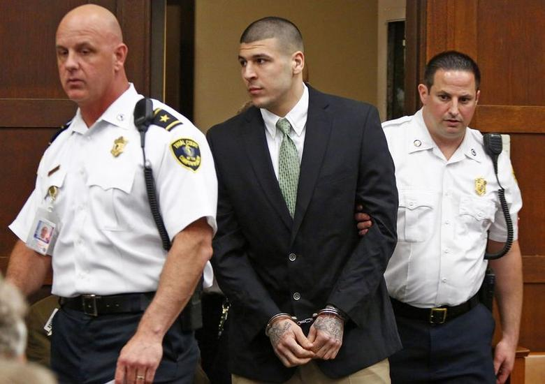 Former NFL player Aaron Hernandez enters the courtroom to be arraigned on homicide charges at Suffolk Superior Court in Boston, Massachusetts in this file photo taken May 28, 2014.    REUTERS/Dominick Reuter/Files