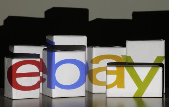An eBay logo is projected onto white boxes in this illustration picture taken in Warsaw, January 21, 2014.  REUTERS/Kacper Pempel