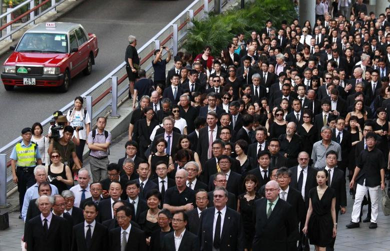 Barristers, solicitors and other members from the legal profession, wearing black, take part in a march of silence in Hong Kong in this June 27, 2014 file photo.  REUTERS/Bobby Yip/Files