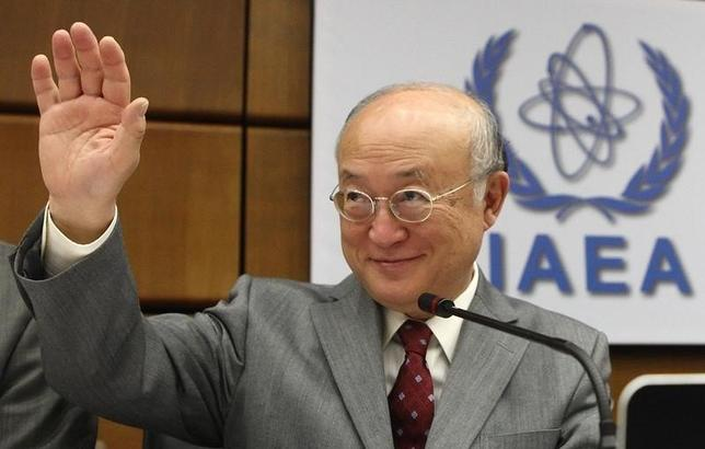 International Atomic Energy Agency (IAEA) Director General Yukiya Amano waves as he arrives for a board of governors meeting at the IAEA headquarters in Vienna June 4, 2014. REUTERS/Heinz-Peter Bader