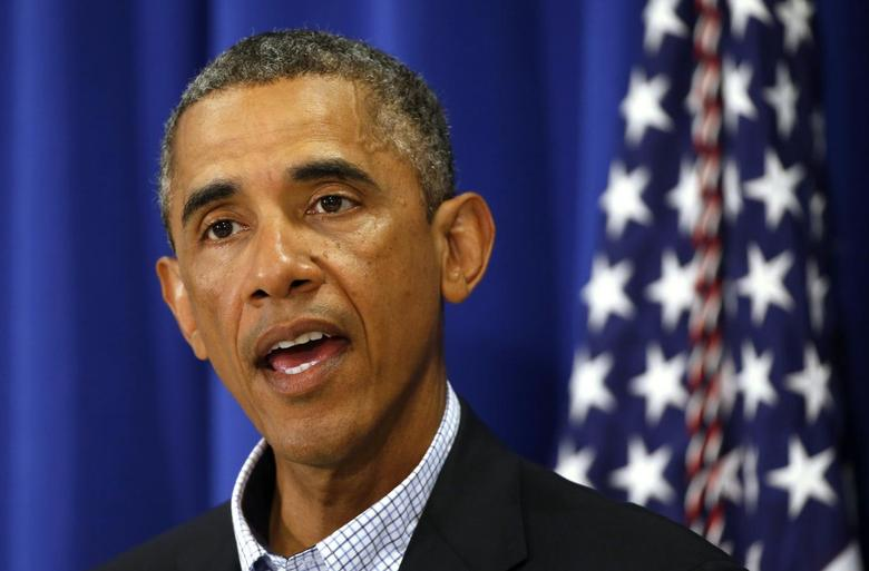 U.S. President Barack Obama speaks about Iraq and also the shooting in Ferguson, Missouri from his vacation on Martha's Vineyard, Massachusetts August 14, 2014. REUTERS/Kevin Lamarque