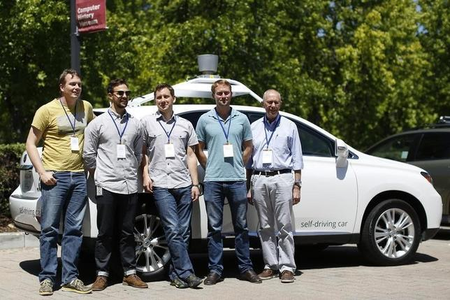 Chris Urmson, (L) director of Google's Self-Driving Car Project, and team members  Brian Torcellini, Dmitri Dolgov, Andrew Chatham, and Ron Medford (R), who is director of safety for the project, pose for a photograph in front of a self-driving car at the Computer History Museum after a presentation in Mountain View, California May 13, 2014.     REUTERS/Stephen Lam