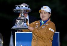 Aug 17, 2014; Pittsford, NY, USA; Inbee Park holds the trophy for winning Wegman's LPGA Championship tournament at Monroe Golf Club. Mark Konezny-USA TODAY Sports