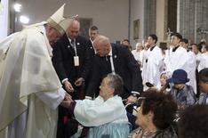 """Pope Francis (L) consoles a woman who had been forced to work as one of the sex slaves, or """"comfort women"""", for Japanese soldiers occupying the country before and during the second World War, during a Mass at Seoul's Myeongdong Cathedral August 18, 2014.  REUTERS/Do Kwang-hwan/Yonhap"""