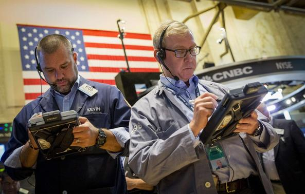 Traders work on the floor of the New York Stock Exchange August 15, 2014.