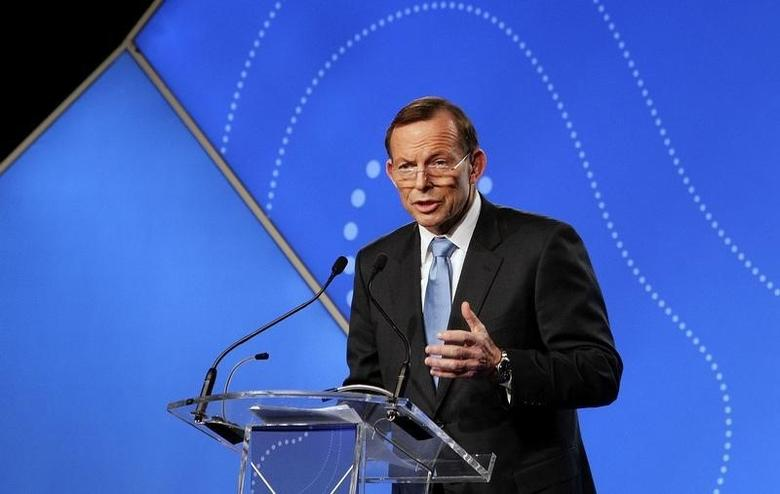 Australian Prime Minister Tony Abbott delivers his keynote speech during the B20 Summit in Sydney, July 17, 2014.    REUTERS/Lisa Maree Williams/Pool