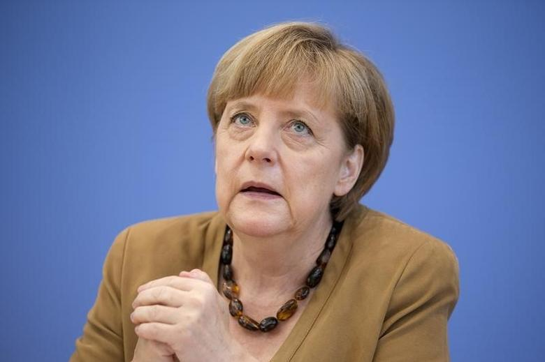 German Chancellor Angela Merkel addresses a news conference in Berlin, July 18, 2014.    REUTERS/Axel Schmidt
