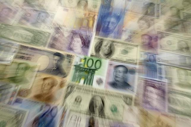 Arrangement of various world currencies including Chinese Yuan, Japanese Yen, US Dollar, Euro, British Pound, Swiss Franc and Russian Rouble pictured in Warsaw January 26, 2011. REUTERS/Kacper Pempel