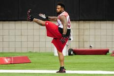 Jul 26, 2014; Tempe, AZ, USA; Arizona Cardinals defensive end Darnell Dockett (90) warms up during training camp at University of Phoenix. Mandatory Credit: Matt Kartozian-USA TODAY Sports