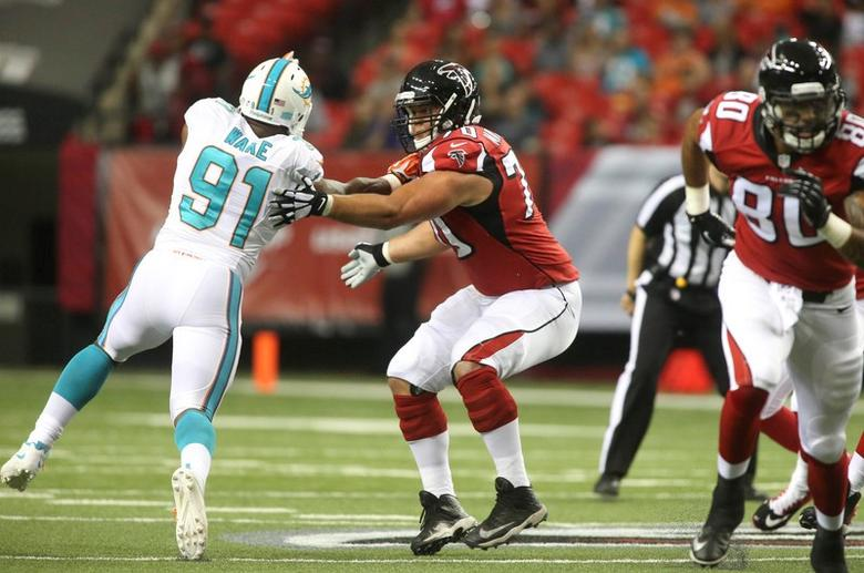 Aug 8, 2014; Atlanta, GA, USA; Atlanta Falcons offensive tackle Jake Matthews (70) blocks Miami Dolphins defensive end Cameron Wake (91) in the first half of their game at Georgia Dome. Mandatory Credit: Jason Getz-USA TODAY Sports