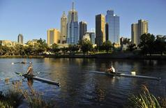 Rowers train at dawn on the Yarra River in Melbourne January 24, 2012. REUTERS/Toby Melville