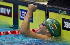 Ruta Meilutyte of Lithuania celebrates winning the women's 100m Medley final during the LEN European Short Course Swimming Championship in Herning, December 14, 2013. REUTERS/Claus Fisker/Scanpix Denmark