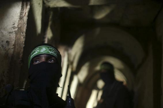 Palestinian fighters from the Izz el-Deen al-Qassam Brigades, the armed wing of the Hamas movement, stand inside an underground tunnel in Gaza August 18, 2014. REUTERS/Mohammed Salem