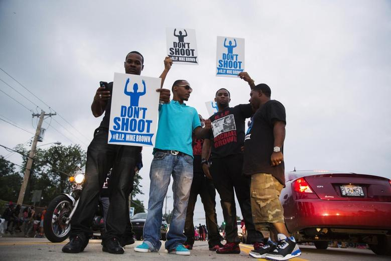 Demonstrators gesture and chant as they continue to react to the shooting of Michael Brown in Ferguson, Missouri August 17, 2014.  REUTERS/Lucas Jackson