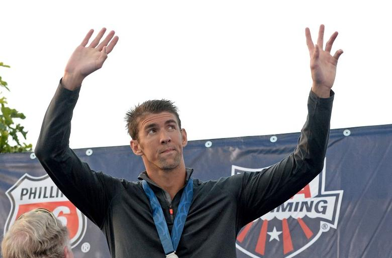 Michael Phelps on the podium after getting his second place medal for the Men's 100 Meter Butterfly final at the USA Swimming Nationals at the William Woollett Jr. Aquatics Complex. Mandatory Credit: Jayne Kamin-Oncea-USA TODAY Sports