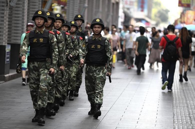 Paramilitary policemen patrol along a street in Shenzhen, Guangdong province, May 27, 2014.  REUTERS/Stringer