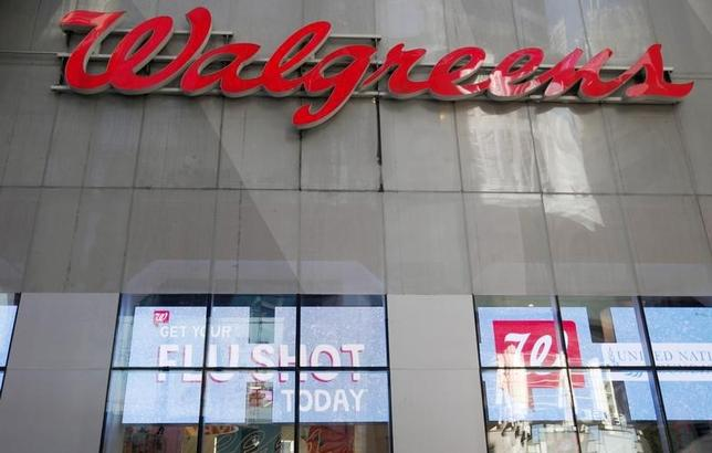 A Walgreens logo is seen outside its store in New York City, September 18, 2013. REUTERS/Mike Segar