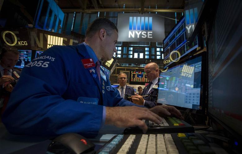 Traders work on the floor of the New York Stock Exchange August 20, 2014. REUTERS/Brendan McDermid