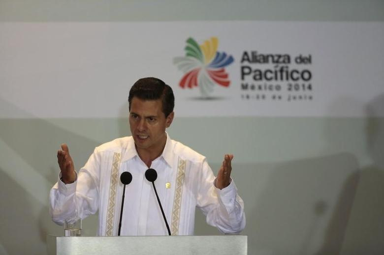 Mexico's President Enrique Pena Nieto speaks after the signing of agreements at the second day of the 2014 Alianza del Pacifico (Pacific Alliance) political summit in Punta Mita in the Nayarit region, in the West Coast of Mexico, June 20, 2014. REUTERS/Jorge Dan Lopez