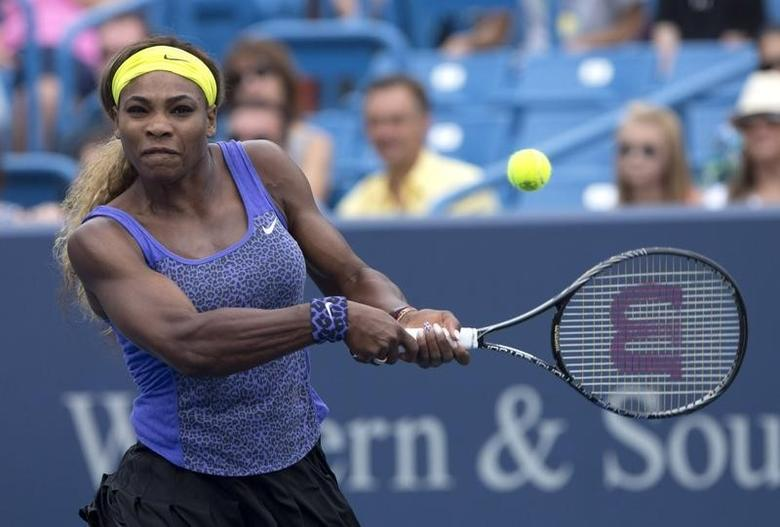 Aug 16, 2014; Cincinnati, OH, USA; Serena Williams (USA) returns a shot against Caroline Wozniacki (not pictured) on day six of the Western and Southern Open tennis tournament at Linder Family Tennis Center. Mandatory Credit: Aaron Doster-USA TODAY Sports
