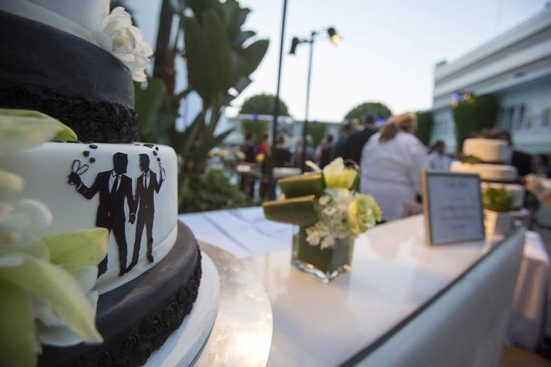 Groom figurines are seen on a cake at a ceremony to celebrate the wedding of Jeff Zarrillo and Paul Katami at Beverly Hilton Hotel in Beverly Hills, California June 28, 2014.    REUTERS/Mario Anzuoni