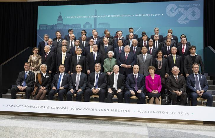 G20 Finance Ministers and central bankers pose for the family portrait during the IMF/World Bank 2014 Spring Meeting in Washington April 11, 2014.      REUTERS/Joshua Roberts