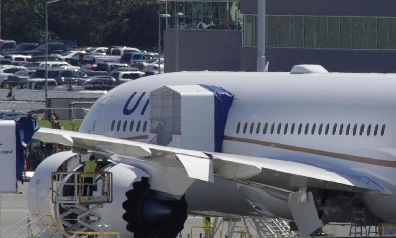 A worker on a lift is pictured near the engine of a Boeing 787 Dreamliner being built for United Airlines in Everett, Washington August 7, 2014. REUTERS/Jason Redmond