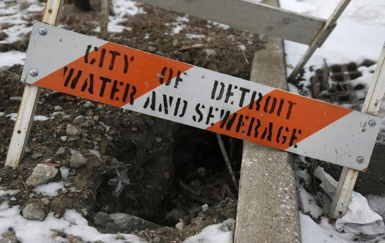A City of Detroit Water and Sewerage safety barricade covers a hole along Jefferson Avenue in the Delray neighborhood of Detroit, Michigan December 13, 2013.  REUTERS/Rebecca Cook
