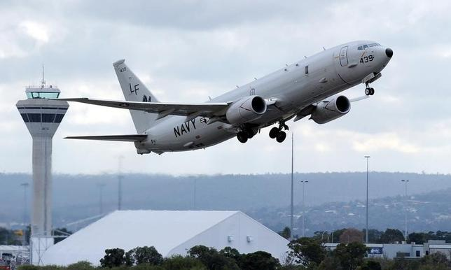 A U.S. Navy P-8 Poseidon aircraft takes off from Perth International Airport in this file photo taken April 16, 2014.   REUTERS/Greg Wood/Pool/Files