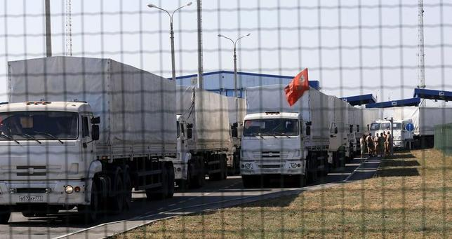 Trucks from a convoy that delivered humanitarian aid for Ukraine are seen inside border crossing point ''Donetsk'' in Russia's Rostov Region as they move back to Russia August 23, 2014. REUTERS/Alexander Demianchuk