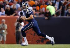 St. Louis Rams quarterback Sam Bradford (8) moves to pass the ball in the first quarter against the Cleveland Browns at FirstEnergy Stadium. Mandatory Credit: Rick Osentoski-USA TODAY Sports