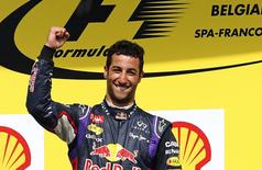 Red Bull Formula One driver Formula One driver Daniel Ricciardo of Australia celebrates after winning the Belgian F1 Grand Prix in Spa-Francorchamps August 24, 2014. REUTERS/Yves Herman