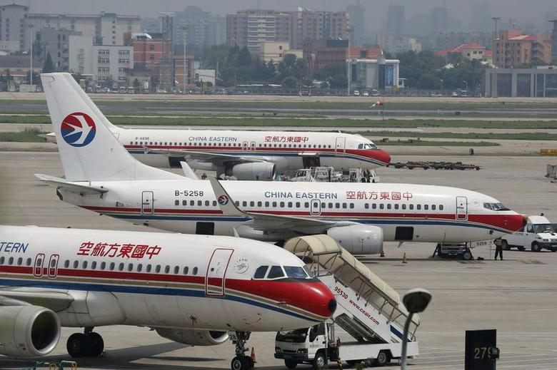 China Eastern Airlines planes are seen on the tarmac at Hongqiao International Airport in Shanghai, July 29, 2014.  REUTERS/Aly Song