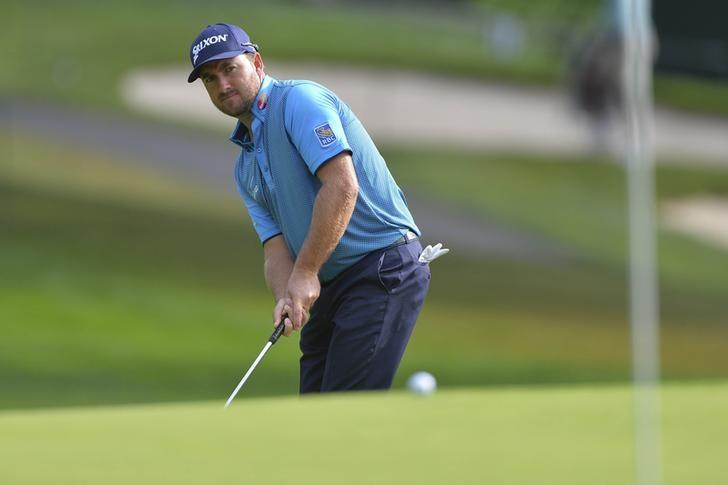 Aug 22, 2014; Paramus, NJ, USA; Graeme McDowell hits his putt on the 11th hole during the second round of The Barclays golf tournament at Ridgewood Country Club. Mandatory Credit: Tommy Gilligan-USA TODAY Sports - RTR43DUM