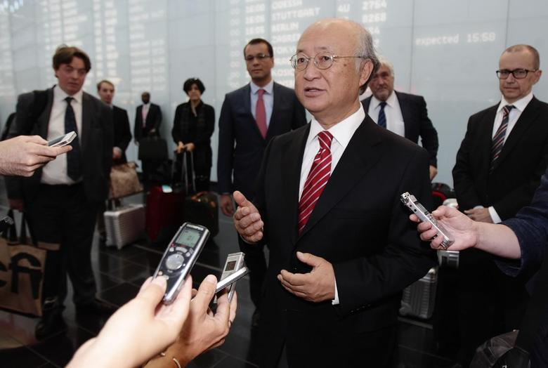 International Atomic Energy Agency (IAEA) Director General Yukiya Amano talks to the media as he arrives at Vienna's airport August 18, 2014.  REUTERS/Heinz-Peter Bader