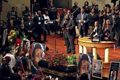 Slain Missouri teen remembered with calls for peace,...