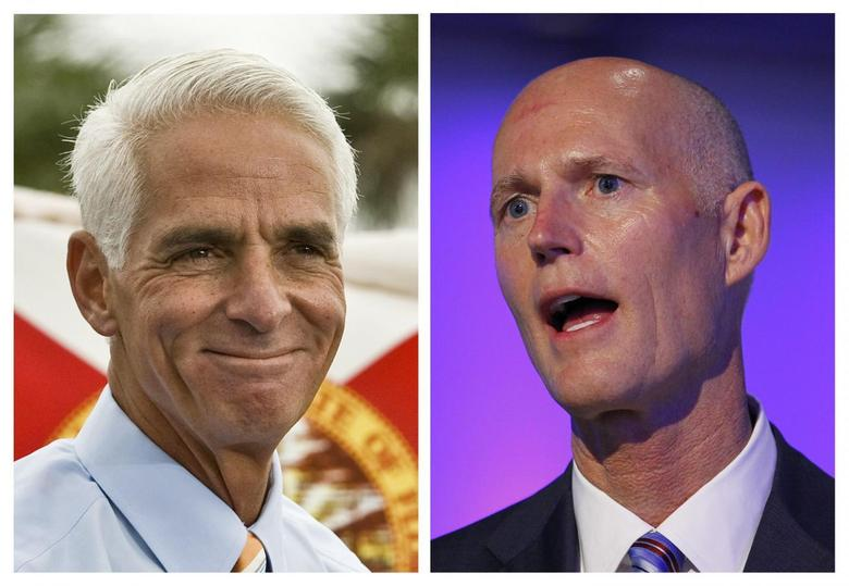 Combination file photos show former Republican Governor Charlie Crist (L), now running for the Democrats, addressing supporters during a rally in St. Petersburg, Florida, November 4, 2013 and Florida Republican Governor Rick Scott speaking at a ceremony in Doral, Florida August 28, 2013. REUTERS/Steve Nesius/Joe Skipper