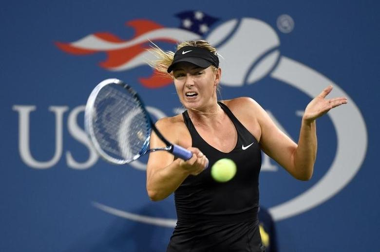 Maria Kirilenko (RUS) hits to Maria Sharapova on opening night in Ashe Stadium at the 2014 U.S. Open tennis tournament at USTA Billie Jean King National Tennis Center. Aug 25, 2014; New York, NY, USA;Robert Deutsch-USA TODAY Sports