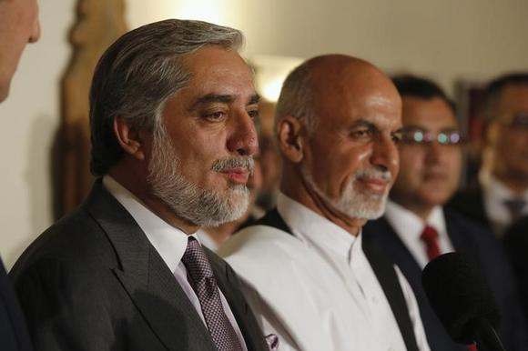Afghanistan's presidential candidate Abdullah Abdullah (L) addresses a news conference with rival Ashraf Ghani (R) at this side as they announced a deal for the auditing of all Afghan election votes at the United Nations Compound in Kabul, late July 12, 2014. REUTERS/Jim Bourg/Files