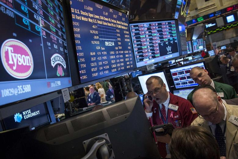 Traders gather at the post that trades Tyson Foods on the floor of the New York Stock Exchange in this June 3, 2014 file photo. REUTERS/Brendan McDermid/Files