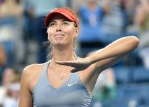 Aug 27, 2014; New York, NY, USA; Maria Sharapova (RUS) reacts after beating Alexandra Delgheru (ROU) on Ashe Stadium court on day three of the 2014 U.S. Open tennis tournament at USTA Billie Jean King National Tennis Center. Mandatory Credit: Robert Deutsch-USA TODAY Sports