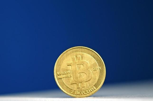 A Bitcoin (virtual currency) coin is seen in an illustration picture taken at La Maison du Bitcoin in Paris July 11, 2014.  REUTERS/Benoit Tessier